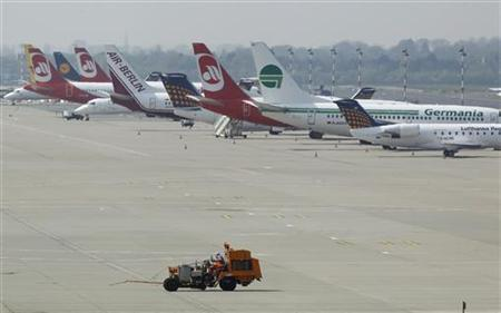 Planes are parked at Duesseldorf's airport April 19, 2010. REUTERS/Ina Fassbender
