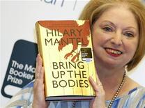 """Author Hilary Mantel poses with her book """"Bring up the Bodies"""", after winning the 2012 Man Booker Prize, at the Guildhall in London October 16, 2012. REUTERS/Luke MacGregor"""