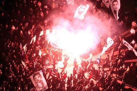Protesters against Egypt's President Mohamed Mursi light fireworks as they gather at Tahrir Square in Cairo January 24, 2013. REUTERS/Mohamed Abd El Ghany