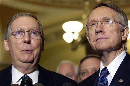New U.S. Senate Minority Leader Mitch McConnell (R-KY) (L) and Senate Majority Leader Harry Reid (D-NV) (R) make remarks after a bipartisan caucus in the Old Senate Chamber on the first day of the 110th Congress at the U.S. Capitol in Washington January 4, 2007. REUTERS/Jonathan Ernst