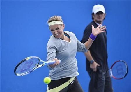 Victoria Azarenka of Belarus hits a return during a practice session watched by her coach Sam Sumyk at the Australian Open tennis tournament in Melbourne January 25, 2013. REUTERS/Toby Melville