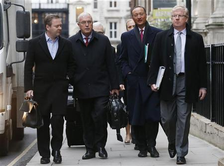 Union Cycliste Internationale (UCI) President Pat McQuaid (2nd L) arrives for an Independent Commission hearing in London January 25, 2013. REUTERS/Suzanne Plunkett