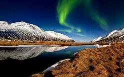 Aurora Borealis are seen over a fjord in Iceland in an undated photo. REUTERS/Ragnar Sigurdsson/Iceland Tourism