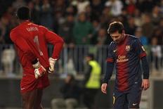 Lionel Messi, do Barcelona, reage em partida no estádio de La Rosaleda em Málaga, na Espanha. Messi voltou a treinar normalmente e estará à disposição para a partida em casa contra o Osasuna pelo campeonato espanhol, disse o clube no sábado. 24/01/2013