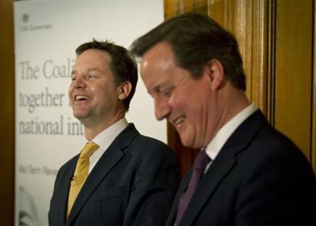 Britain's Prime Minister, David Cameron (R), and Deputy Prime Minister, Nick Clegg, laugh during a news conference in 10 Downing Street in central London January 7, 2013. REUTERS/Peter Nicholls/Pool