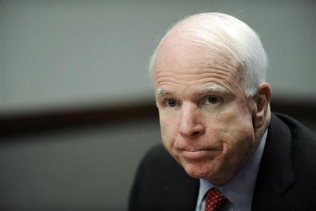 U.S. Senator John McCain (R-AZ) listens to questions during the Reuters Washington Summit in the Reuters newsroom in Washington, November 8, 2011. REUTERS/Jonathan Ernst