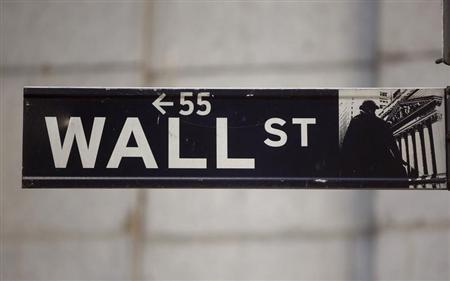The Wall Street sign is seen near the New York Stock Exchange, November 19, 2012. REUTERS/Chip East