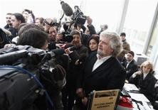Five-Star Movement activist and comedian Beppe Grillo talks to the media before the shareholders meeting at Banca Monte dei Paschi in Siena, January 25, 2013. REUTERS/Stefano Rellandini