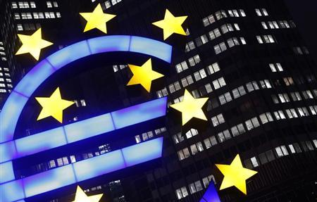 An illuminated euro sign is seen in front of the headquarters of the European Central Bank (ECB) in the late evening in Frankfurt January 8, 2013. The cost of living in the euro zone rose more than expected in December but remained benign enough to allow a possible cut in interest rates in 2013 to support the bloc's feeble economy. The ECB's Governing Council meets on Jan. 10, with policymakers appearing unwilling to countenance a rate cut so early in the year. REUTERS/Kai Pfaffenbach (GERMANY - Tags: BUSINESS POLITICS)
