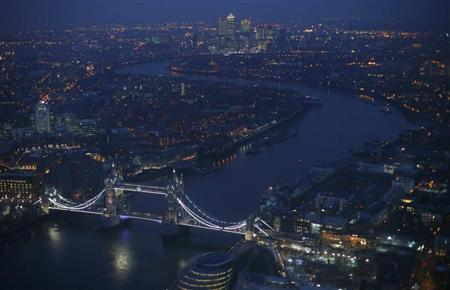 Tower Bridge and the Canary Wharf financial district (at rear) are seen at dusk in an aerial photograph from The View gallery at the Shard, western Europe's tallest building, in London January 8, 2013. REUTERS/Andrew Winning
