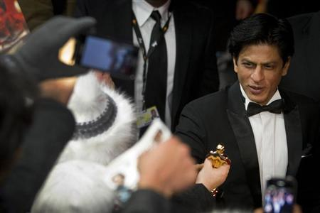Shah Rukh Khan arrives for the screening of the movie ''Don - The King is back'' at the 62nd Berlinale International Film Festival in Berlin February 11, 2012. REUTERS/Thomas Peter/Files