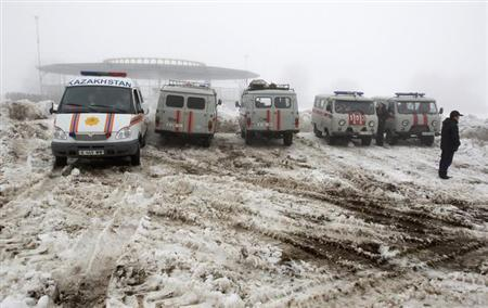 Emergencies Ministry vehicles and ambulances are parked near the site of the plane crash outside Almaty January 29, 2013. REUTERS/Shamil Zhumatov