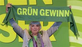"""File photo of German Green Party co-leader Claudia Roth holding up a scarf reading: """"Green will win"""" after her re-election at the party convention of the Green Party in Hanover, November 17, 2012. REUTERS/Fabian Bimme/Files"""