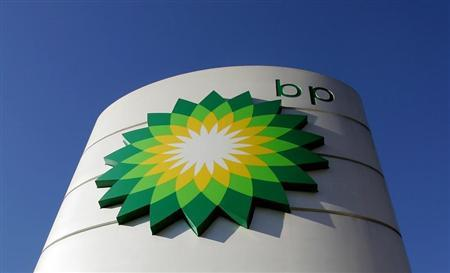 The BP logo is seen at a petrol station in London, October 26, 2004. NTRES REUTERS/Toby Melville