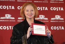 """Author Hilary Mantel holds her award for the overall prize for her book """"Bring up the Bodies"""" at the Costa Book Awards in central London, January 29, 2013. Mantel won the award for best overall book. REUTERS/Andrew Winning"""