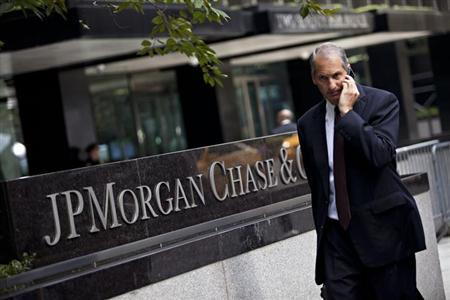 A man walks past JP Morgan Chase's international headquarters on Park Avenue in New York July 13, 2012. REUTERS/Andrew Burton/Files