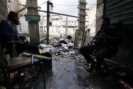 A Free Syrian Army fighter sits next to a waterpipe as he looks towards a mirror to monitor forces loyal to Syria's President Bashar al-Assad in old Aleppo, January 29, 2013. REUTERS/Zain Karam (SYRIACONFLICT - Tags: POLITICS CIVIL UNREST)