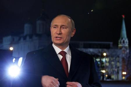 Russian President Vladimir Putin speaks after recording the traditional televised New Year's address to the nation in Moscow, December 27, 2012. REUTERS/Alexander Zemlianichenko/Pool
