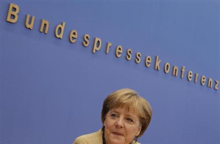 German Chancellor Angela Merkel addresses media during a news conference at Bundespressekonferenz in Berlin, September 17, 2012. Merkel said on Monday that she hoped to have agreed by the end of the year a process towards closer political co-ordination and greater accountability within the euro zone. REUTERS/Tobias Schwarz (GERMANY - Tags: POLITICS)