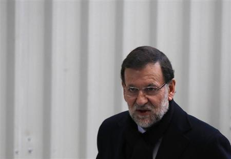 Spanish Prime Minister Mariano Rajoy arrives at Parliament to attend a government's control session in Madrid January 30, 2013. REUTER/Sergio Perez