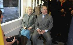 Britain's Prince Charles and his wife Camilla, Duchess of Cornwall, travel on a Metropolitan line tube train from Farringdon station to King's Cross station, as they mark 150 years of the London Underground January 30, 2013. REUTERS/Chris Jackson/pool