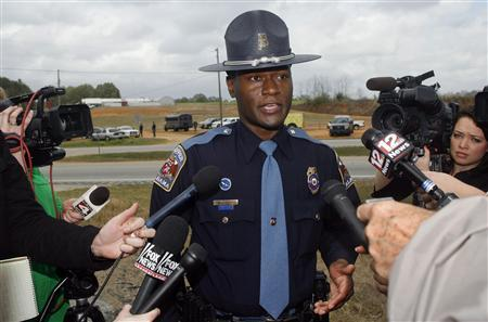 Alabama State Trooper Charles Dysert speaks to the media near the scene of a shooting and hostage taking in Midland City, Alabama, January 30, 2013. REUTERS/Phil Sears (UNITED STATES - Tags: CRIME LAW)