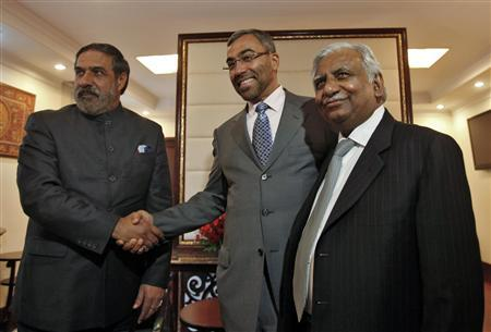 India's Trade Minister Anand Sharma shakes hands with Ahmed Ali-al-Sayegh, a board member of Abu Dhabi's Etihad Airways, as Jet Airways Chairman Naresh Goyal (L-R) looks on, before their meeting in New Delhi January 31, 2013. REUTERS/Mansi Thapliyal