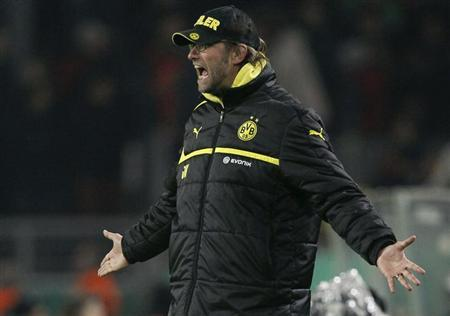 Borussia Dortmund coach Juergen Klopp reacts during his team's German DFB Cup (DFB Pokal) match against Hanover 96 in Dortmund December 19, 2012. REUTERS/Wolfgang Rattay