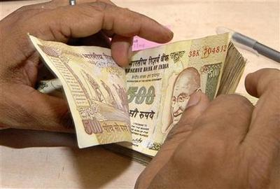 Rupee posts first monthly gain in four