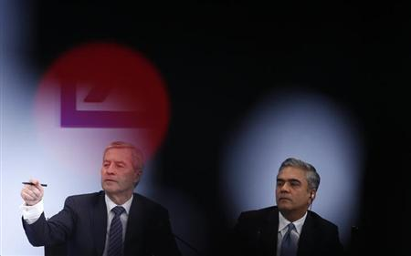 Juergen Fitschen gestures next to Anshu Jain (R), Co-Chairmen of the Management board and the Group Executive Committee of Germany's largest business bank, Deutsche Bank AG during the annual news conference in Frankfurt January 31, 2013.