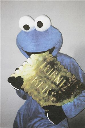 A handout picture from Hannoverische Allgemeine Zeitung newspaper shows an extortionist dressed as the 'Cookie Monster' from children's television series 'Sesame Street' pretending to take a bite from the golden biscuit, in Hanover, January 29, 2013. One of Germany's most famous biscuit-makers has appealed to an extortionist dressed as the 'Cookie Monster' to return its prized golden biscuit emblem. The Bahlsen biscuit company's emblem has hung above its headquarters in Hanover since 1913 and was first reported stolen a week ago. Just days after it went missing a ransom note arrived at the local newspaper which included a photo of the thief. In a message posted on Facebook on Thursday and addressed to the monster, Bahlsen promised to donate 52,000 packets of biscuits to charities if the 20 kg (44 pound) golden biscuit was returned. The original ransom note demanded that Bahlsen give biscuits to children in hospitals across Hanover and donate a 1,000-euro ($1,400) reward for the emblem's return to an animal home. A spokeswoman denied media suggestions that the theft and ransom note were part of a marketing stunt and said the firm was anxious to recover the emblem as soon as possible. REUTERS/Michael Thomas/HAZ/Handout