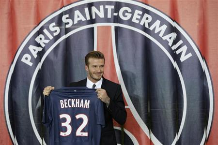 Soccer player David Beckham presents his new jersey after a news conference in Paris January 31, 2013. REUTERS/Philippe Wojazer