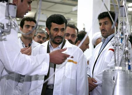 Iranian President Mahmoud Ahmadinejad (C) visits the Natanz nuclear enrichment facility, 350 km (217 miles) south of Tehran, April 8, 2008. REUTERS/Presidential official website/Handout