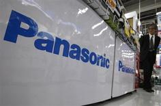 A customer looks at electronic products near Panasonic Corp logos at an electronic store in Tokyo June 27, 2012. REUTERS/Yuriko Nakao