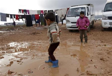 Children play in mud at the Bab Al-Salam refugee camp in Azaz, near the Syrian-Turkish border, January 24, 2013. REUTERS/Zain Karam
