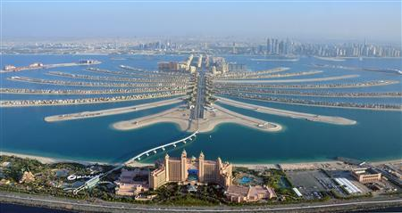 An aerial view of Atlantis hotel is seen with The Palm Jumeirah in Dubai in this December 21, 2009 file photo. The revolts that began in Tunisia at the end of 2010 and spread across the Middle East and North Africa had a devastating impact on tourism, but not everyone in the region lost out. While recovery from the turmoil has been at best tentative, at worst non existent, places where the Arab Spring has not reached have been unexpected beneficiaries. REUTERS/Matthias Seifert/Files