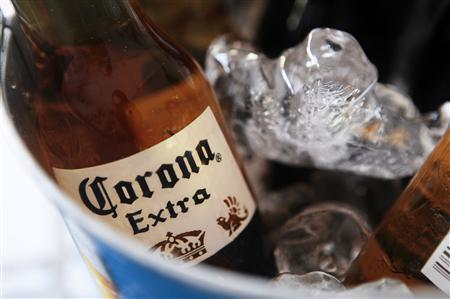 A bottle of Corona beer sits in a cooler at a bar in Cancun in this file photo from June 29, 2012. REUTERS/Victor Ruiz Garcia/Files
