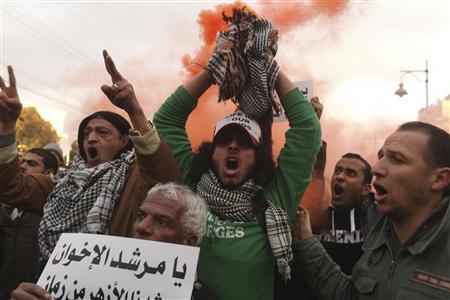 One dead, dozens hurt as police clash with Egypt protesters