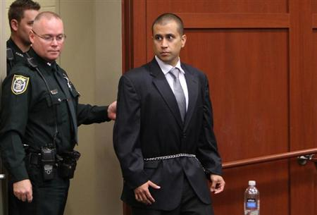 George Zimmerman (R) arrives at the courthouse for his appearance before Circuit Judge Kenneth Lester Jr. at the Seminole County Courthouse in Sanford, Florida, April 20, 2012 . REUTERS/Gary W. Green/