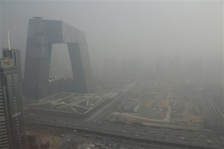 The China Central Television (CCTV) building is seen next to a construction site in heavy haze in Beijing's central business district, January 14, 2013. REUTERS/Jason Lee
