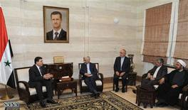 Syria's Prime Minister Wael al-Halqi (L) meets Iran's Supreme National Security Council Secretary Saeed Jalili (2nd L) in Damascus Feburary 2, 2013, in this handout photograph released by Syria's national news agency SANA. REUTERS/Sana