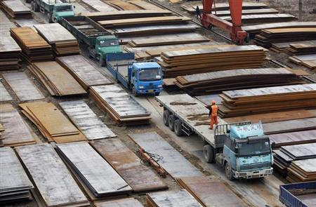 A labourer stands atop a lorry at a steel market in Wuxi, Jiangsu province January 11, 2013. REUTERS/Aly Song