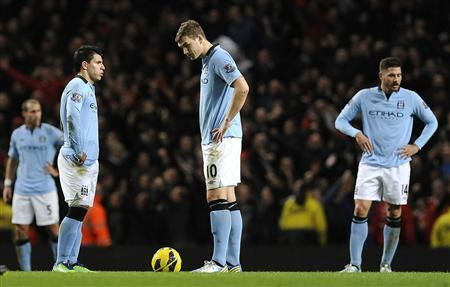 Manchester City's players react after Liverpool's Steven Gerrard (unseen) scored during their English Premier League soccer match at the Etihad Stadium in Manchester, northern England February 3, 2013. REUTERS/Nigel Roddis
