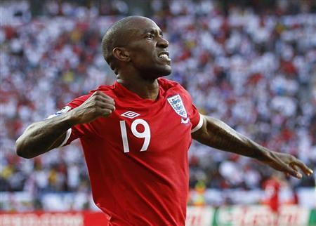England's Jermain Defoe celebrates his goal during the 2010 World Cup Group C soccer match against Slovenia in Port Elizabeth June 23, 2010. REUTERS/Carlos Barria