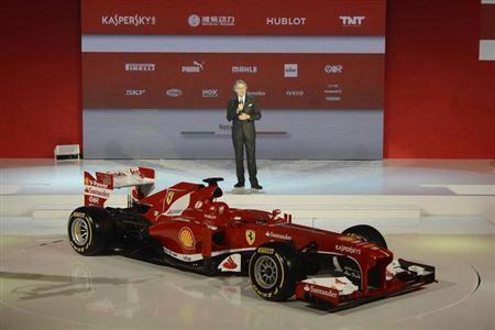 Ferrari boss Luca Cordero di Montezemolo presents the new Ferrari F138 Formula One car in this official undated handout image distributed by the Ferrari Press Office February 1, 2013. REUTERS/Ferrari Press Office/Handout