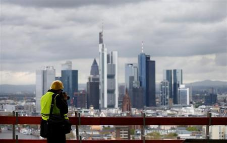 photographer takes a picture of the skyline during a guided tour of the construction site of the new headquarters of the European Central Bank (ECB) in Frankfurt, April 26, 2012.
