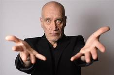 "Musician Wilko Johnson poses for a photograph at his home in Westcliff - on- sea, Essex, southern England February 1, 2013. Johnson, cult guitarist from 1970s beat band Dr Feelgood and herald of English punk rock, is on a high - even though he is dying of pancreatic cancer. The musician, songwriter and sometime actor has watched with amazement as a planned tour of farewell concerts sold out and interest has surged in almost anything he has touched, including the 2009 award-winning documentary ""Oil City Confidential."" Photograph taken on February 1, 2013. REUTERS/Paul Hackett"