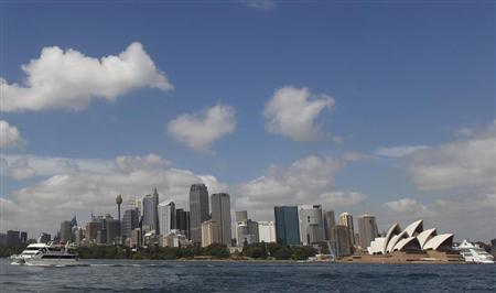A catamaran (L) leaves the central business district, with the Sydney Opera House seen in the background, in Sydney December 18, 2012. REUTERS/Daniel Munoz