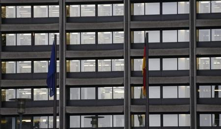 he flags of the European Union and Germany hang in the rain outside Germany's federal bank, Deutsche Bundesbank in Frankfurt, February 4, 2013. REUTERS/Kai Pfaffenbach