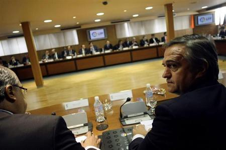 Jose Luis Astiazaran (R), President of Spain's Professional Soccer League (LFP), attends a meeting at the headquarters of the LFP in Madrid November 6, 2009. REUTERS/Susana Vera/Files